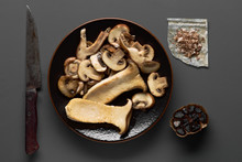 Mushrooms And Roasts In Iron Pan Gray Board, Top View
