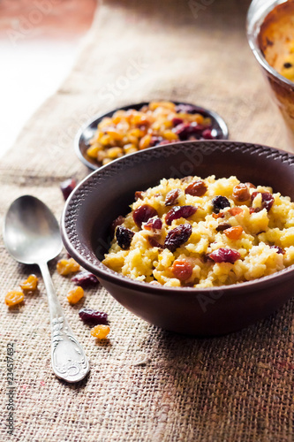 Valokuva  Sweet millet porridge with raisins and dried cranberries