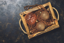 Christmas Tree Toys, Balls And Beads In A Wooden Box. Top View, Flat Lay, Copy Space.Golden Christmas Balls