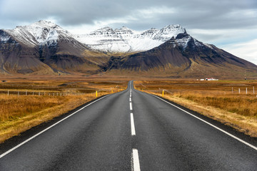 Towering Mountains along a Deserted Road in Iceland on a Cloudy Autumn Day