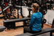 A fitness girl having a break after a hard workout. workout, woman, blue gym clothes;