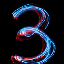 The Neon Number 3, Blue Light Image, Long Exposure With Colored Fairy Lights, Against A Black Background