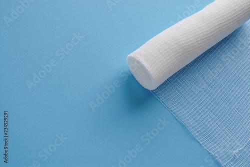 Leinwand Poster Sterile bandage on blue.