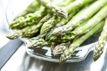 Macro Close Up On Raw Asparagus Spears In A Glass Dish