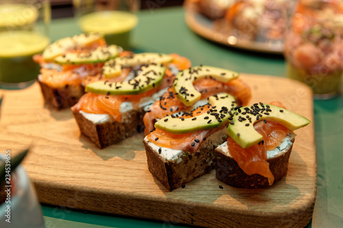 Canapes with salmon and avocado slices