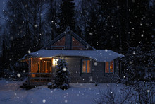 Romantic View Of Old Traditional Wooden Forest Cabin In The Woods Embedded In Scenic Northern Winter Wonderland Scenery
