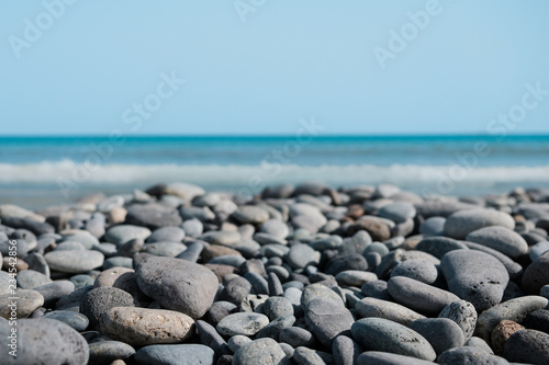 pebble stone beach - stones at ocean coast - Canvas Print