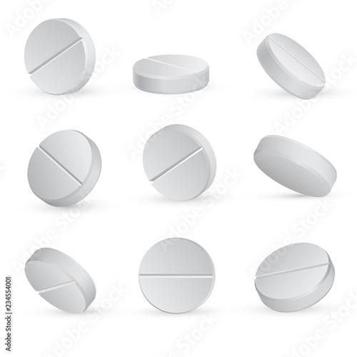 Round white medical pills in different positions Obraz na płótnie