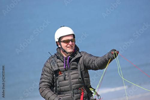 Paraglider preparing his wing