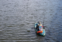 Man Fishing In A Kayak On A Pe...