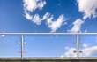 Leinwanddruck Bild - glass fence with clouds sky in background. 3D illustration