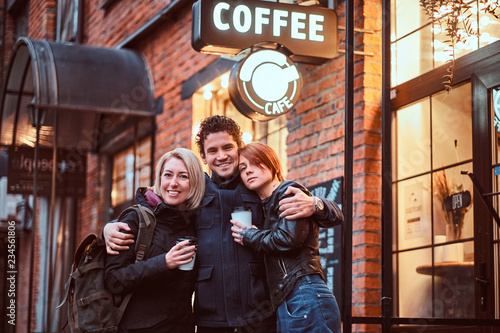 Printed kitchen splashbacks Kyoto Happy friends standing together in an embrace near a cafe outside.