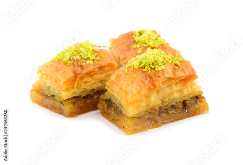 Photo Baklava Pastry with Pistachio. Isolated on White Background.