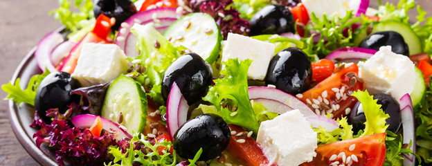 Fototapeta Greek salad with fresh vegetables and feta cheese