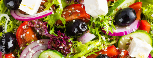 Stampa su Tela Greek salad with fresh vegetables and feta cheese