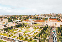 Lisbon Cityscape. View At Jeronimos Monastery (or Hieronymites Monastery) And Emprie Square And Park. Aerial View From The Top Of The Monument Of The Discoveries.