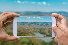 Hands With Smartphone Photogra...