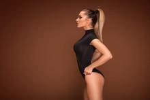 Sensual Woman Posing On Brown Background.