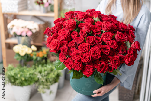 Photo  Big luxury bright bouquet in the hands of a cute girl