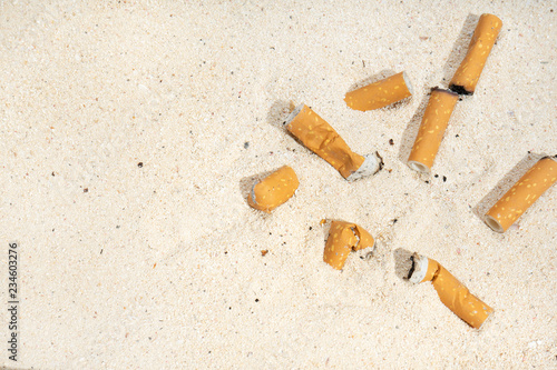 Cigarette butts on the beach Fototapeta