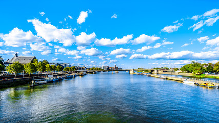 The Maas River (Meuse) as it flows through the historic city of Maastricht in the Netherlands. Viewed from the Sint Servaasbrug (St. Servatius Bridge)