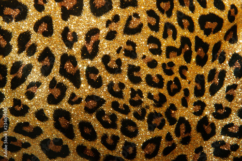 leopard texture of small sequins. bright beautiful background. glamour