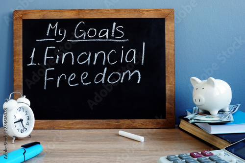 Fotografija My goals and financial freedom written on a blackboard.