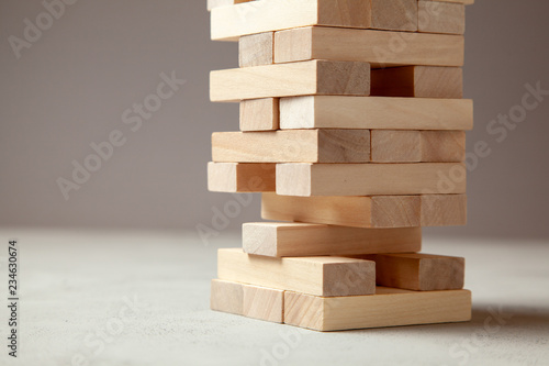 Tower of wooden blocks on gray background Fototapet