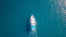 Aerial Image Of A Small Fishing Boat Roaring Along The Mediterranean Sea