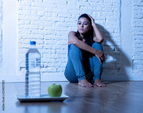 Fototapeta Depressed starving young woman on apple and water diet obraz