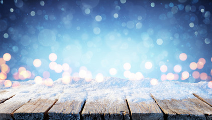 Winter Background - Snowy Table With Christmas Lights In The Night