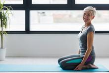 Portrait Of Smiling Beautiful Senior Woman Health Instructor. Best Exercises For Older Women. Yoga Classes For Seniors.