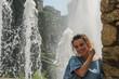 Young beautiful girl near the fountain
