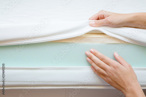 Fotografie, Obraz  Woman's hands touching different layers of new mattress