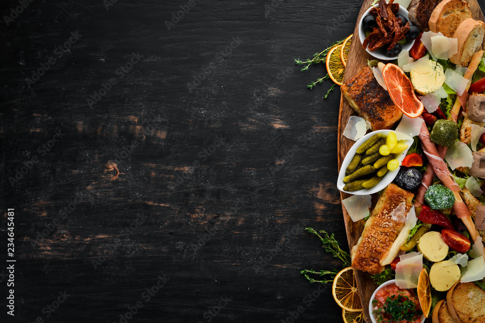 Fototapeta A set of food. Snacks of Italian cuisine. On a wooden background. Top view. Free copy space