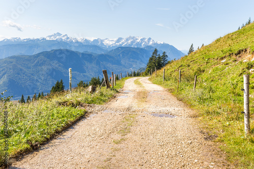 Rural road green meadow mountains range landscape scenic view