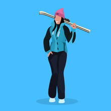 Woman Skier Holding Skis Happy...