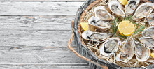 Fresh Oysters With Lemon In Wo...
