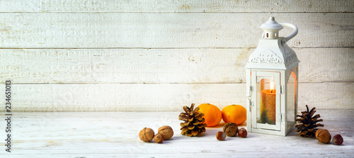 candle light lantern with pine cones, nuts and tangerines as christmas decoratio Canvas Print