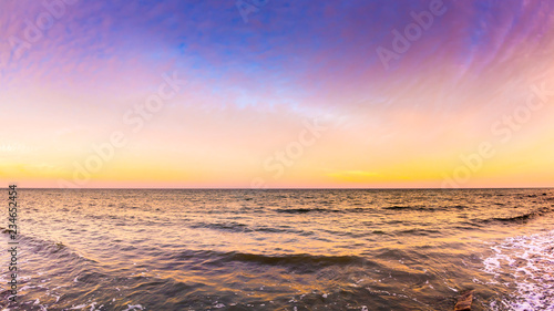 Sunset at the ocean as a background