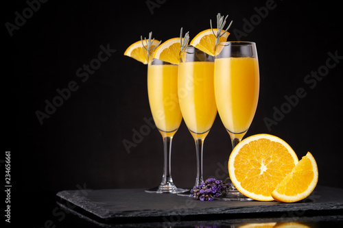 Foto op Plexiglas Cocktail Mimosa cocktails in champagne glasses