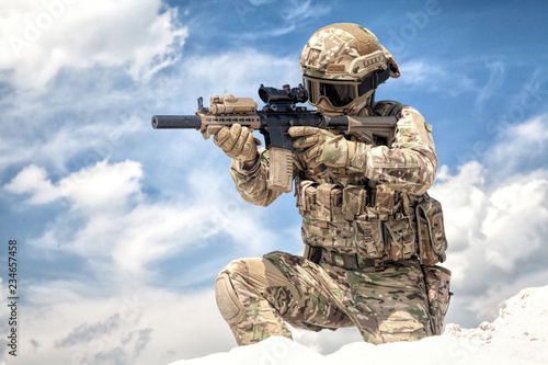 Fully equipped with tactical ammunition airsoft player in military camouflage un Wallpaper Mural