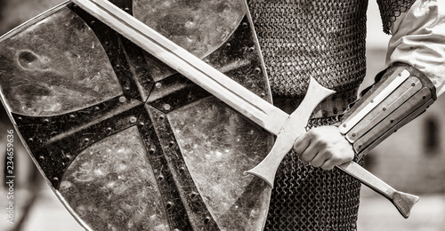 Closeup view on traditional medieval knight with shield and sword Tableau sur Toile