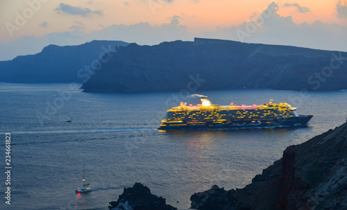 Photo  A huge cruise ship running on the sea