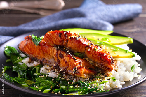 Salmon teriyaki rice bowl with spinach and avocado.
