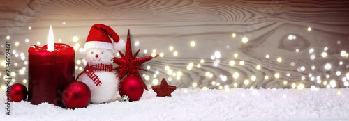 Obraz na plátně  Advent candle and Snowman with red Christmas decoration isolated.