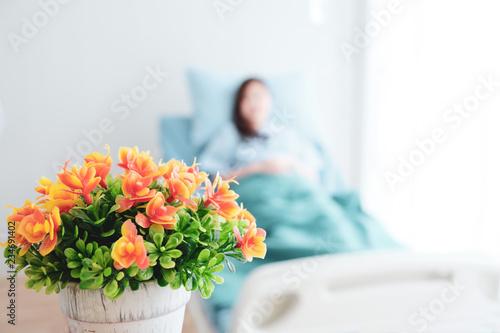 Leinwand Poster Orange flowers bring patients visit.