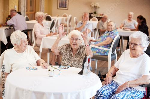 Senior Woman Winning Game Of Bingo In Retirement Home Canvas Print