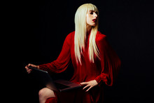 Portrait Of A Beautiful Blonde Woman Isolated On Black Studio Background