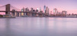 Panorama of downtown Manhattan with Brooklyn bridge from east river at sunrise